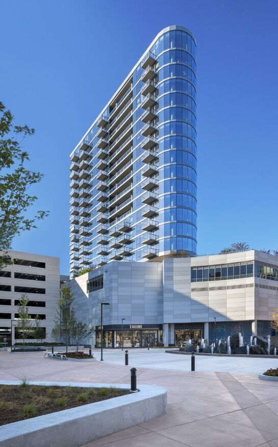 The building with residences at NewCity is faced with a curved, metal-and-glass façade for optimal views.