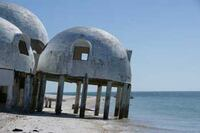 Owner Struggles to Save Beachfront Domes