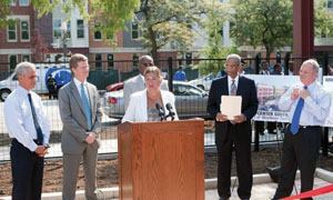 Amy Anthony, with Chicago and federal leaders, celebrates a $30.5 million Choice Neighborhoods grant in August.