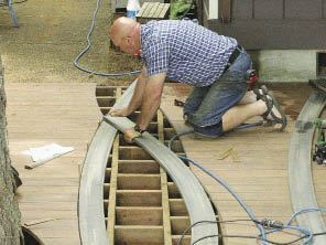 Figure 5. The curved decking of the inlay was used as a pattern to mark the field decking for cutting. Then, the curved pieces were laid in place and marked for cutting from below.