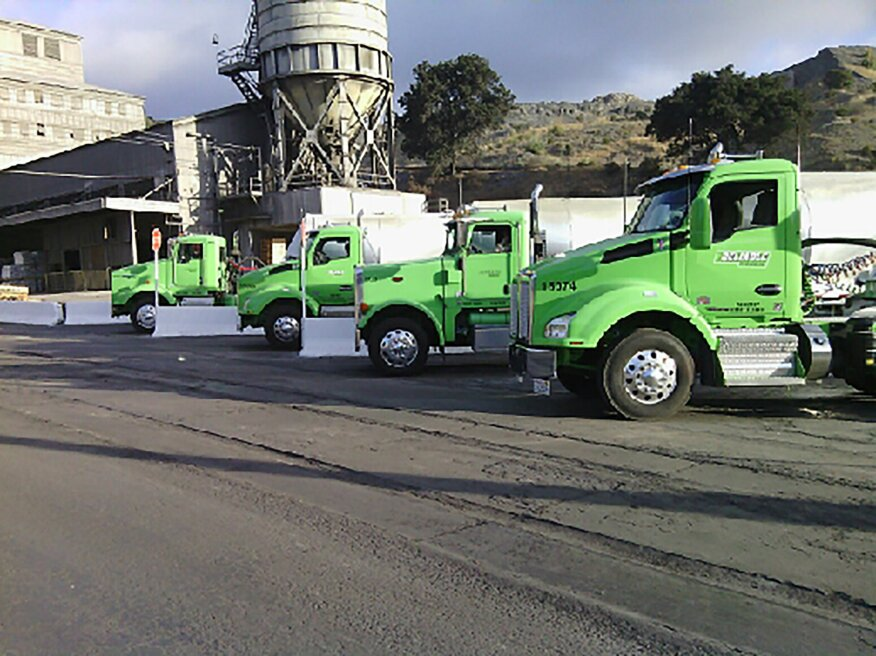 Four vehicles in Reliable's fleet at a jobsite.