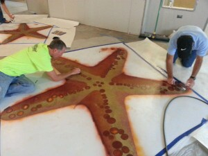 From left: Todd A. Scharich, decorative concrete specialist with the American Society of Concrete Contractors, and Concrete Construction's Bill Palmer complete work on a starfish stencil design.
