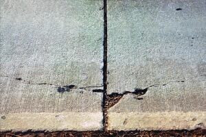 Poor bonding of the topping to the base course can be a primary reason for spalling. Bond coats can prevent this type of damage.