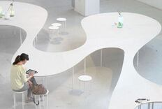 This Minimalist Table Combines Collaborative and Solo Workspaces