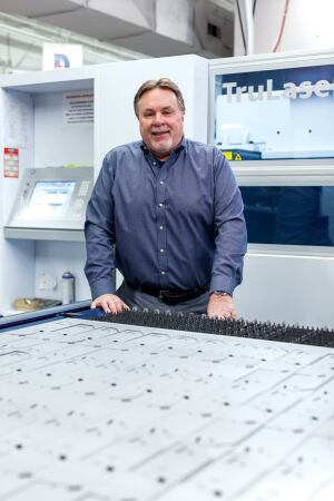 George Closs, executive vice president for engineering and operations at Edison Price Lighting, has helped oversee the company's manufacturing evolution by adding digitally controlled tools, such as Trumpf's TruLaser 1030 laser fabrication center.