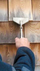 Figure 8. Wide-jawed locking pliers exert enough clamping pressure to allow a shingle to be wiggled free of its nails.