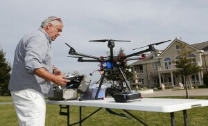 Curt Walton prepares a DJI S900 drone to shoot aerial video of a $12.5 million home for sale in Alamo, Calif., on Friday, Feb. 26, 2016. The use of video from drones as a marketing tool to help sell multi-million dollar homes is rapidly expanding even as the FAA formulates the use of drones for commercial use. (Gary Reyes/Bay Area News Group)