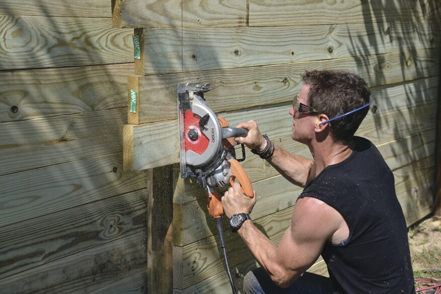 After setting his saw's cutting depth to the thickness of the planks and snapping a line, the author cut them to length in place.