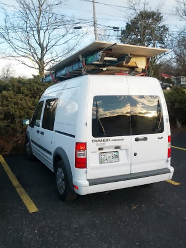 We've heard some of the good, but what about the limitations to this sort of setup? While I've successfully carried sheets of plywood or long bundles of trim on the roof rack, you're not going to be hauling a lot of material, and you're certainly not going to be towing. With its 2L 4-cylinder engine the Transit is doing well to get itself down the road. The interior is Spartan, and the handling and ride are not what you'd call plush. There is a fair amount of road noise in the cab, and it tends to vibrate annoyingly at stop lights. If you get one of these vehicles you'll need to steer clear of drive-throughs and parking garages. Trust me on this one.