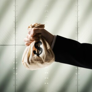 Businessman Holding Money Bag