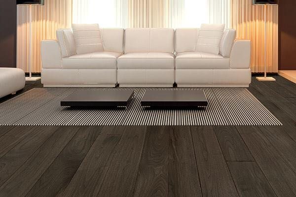 """Engineered wood flooring was once offered in a limited number of wood species, but the durable flooring option has come a long way in terms of style. Charcoal walnut, part of Terra Legno's Annoso Collection, is manufactured through a process that uses younger and smaller trees rather than old-growth hardwoods. The 5""""-wide, 9/16""""-thick planks have an oil finish. terralegno.com"""