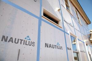 Georgia-Pacific. Nautilus combines OSB structural sheathing and a water-resistive barrier in one panel, reducing installation time; the panels install like traditional sheathing and seal with Nautilus seam tape. The panels include nailing guides that are visible through the integrated building wrap. The Blue Ribbon OSB is SFI-certified. 800.284.5347. www.builditbetter.com.