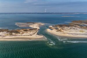 The breach cut by Sandy at Old Inlet on Fire Island is good for wildlife and water quality, scientists say. But it may not be so good for homes near the water, where tidal flows have been flooding streets daily, according to Long Island townsfolk.