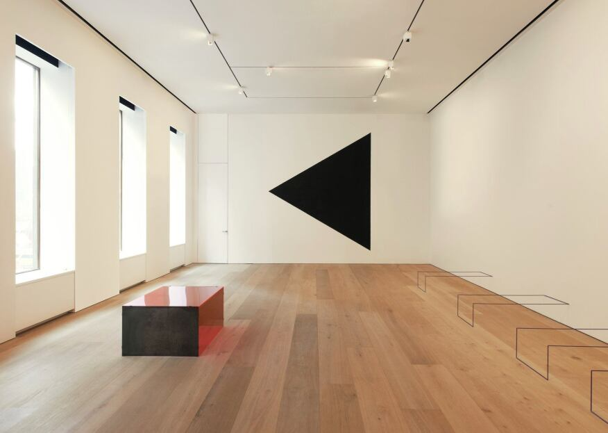 A second-floor gallery benefits from deep street-facing windows.