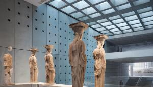 The caryatids look across Tschumi's central atrium to pediment sculptures from the Parthenon.