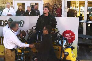 Johannes Schulze Vohren, (left) vice president of sales and product support for Wacker Neuson, congratulates and presents the customized CRT 48-35VX ride-on trowel to Tony Lampasona, president of Lindsay Lampasona Concrete Building Partners, Norfolk, MA.  Winner of the 2011 Wacker Neuson Trowel Challenge competition, Stu Angeli sits on the grand prize.  For his winning operating skills, Angeli receives a one week vacation to the Caribbean.