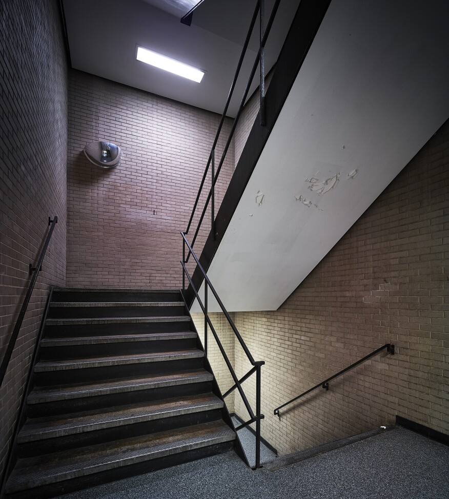 An existing staircase enclosed by the brick core