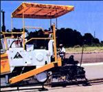 First covered in the September 1982 issue, zero-slump, roller-compacted concrete (RCC) was touted for its high strength and ability to be placed with large-volume equipment. This RCC paver has a vibrating, couble-tamping screed said to compact the material to 95% of laboratory maximum density. (January 1988)