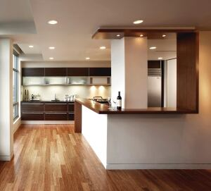 A bamboo counter winds from floor to ceiling, creating a distinctive boundary between the kitchen and the adjacent dining area.