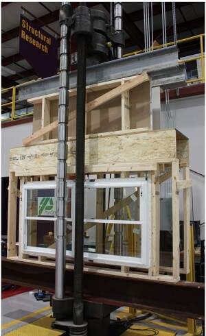 Engineers at the Home Innovation Research Labs loaded integrated band joist headers with more than 4,000 pounds per lineal foot to establish that the assembly could carry require roof, wall, and floor loads without compromising the performance of windows in the wall below.