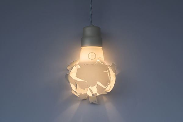 Swedish studio Gässling achieved the look of shattered glass by 3D printing the diffuser of its Wreaking Ball lamp.