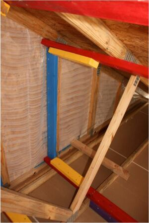 Reinforcing retrofit framing in a test building in South Carolina, color-coded for clarity, awaits wind-tunnel testing. The data from the experiment are expected to validate some of the reinforcing requirements, but may suggest changes in others, researchers report.