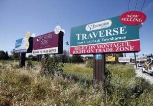 Real estate signs fill the sky on Oakland Road Tuesday afternoon, April 5, 2016, in north San Jose, Calif. (Karl Mondon/Bay Area News Group)