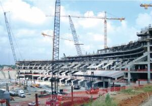 The stadium includes cast-in-place and precast elements to create a panoramic view of the stadium for spectators. Cast-in-place columns are poured and cured first. Then precast seating units are lifted into place.