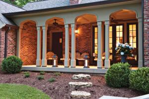 """Separate but Equal The porch is sandblasted concrete ó """"poor manís limestone,"""" the homeowner calls it ó while the entry steps and front door archway are real limestone. Since the materials arenít adjacent to each other, viewers donít realize theyíre different."""