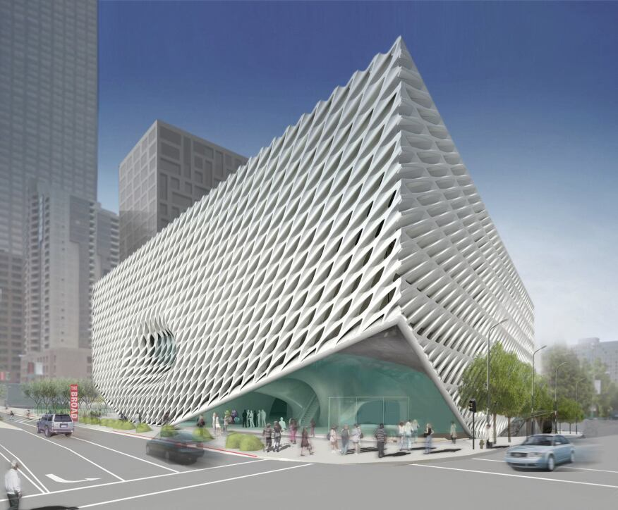 """View of the east corner entrance, showing the perforated concrete cladding and the """"pucker"""" along Grant Avenue that marks a conference room."""