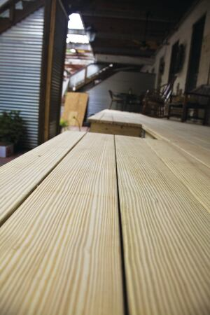 Not all treated southern yellow pine has clear vertical grain like this, of course, but your PT decking will look better if you run it lightly through a power planer to remove grade marks prior to installation.