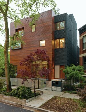 The house's entry is on the eastern edge of the lot. An ipe rainscreen conceals a steel frame   with composite decking.