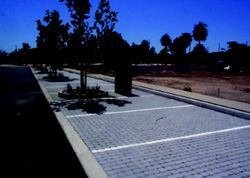 Santa Monica's Virginia Avenue Park parking lot was remodeled using block pavers  with small gravel in the gaps in the parking stalls. This made the pavement  more pervious and helped absorb stormwater runoff.