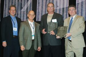 (L-R) Mark Snyder, ACPA-Pennsylvania Chapter; Mike Shayeson, The Harper Company (and 2011 Chairman of the ACPA Board of Directors); Jim Crowley, Golden Triangle Construction Co., Inc., and John Becker, ACPA-Pennsylvania Chapter celebrate the presentation of ACPA's Lifetime Pavement Recognition Award.