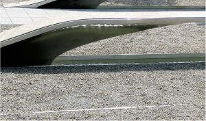 "Gravelpave2 from Invisible Structures is a porous paving system that holds gravel in place without sacrificing drainage. Shown here at the Pentagon Memorial, the system keeps the gravel in place and is stable enough for rolling a wheelchair or driving a truck on top. Available in black, tan, gray, and terra cotta.    3'-4"" x 3'-4"" or 1'-7 4/5"" x 1'-7 4/5"" units  invisiblestructures.com"