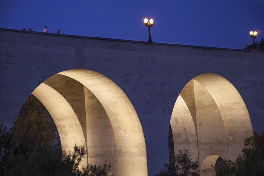 The lighting design highlights the bridge's interior arches giving form to the structure at night.