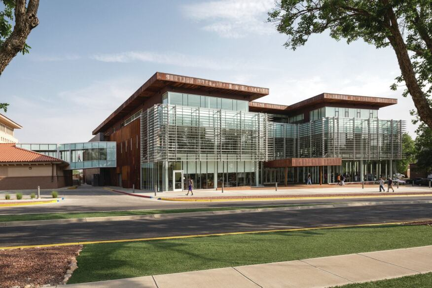 New Mexico Highlands University's new student center strategically manages the hot sun. A sophisticated sun shade system mitigates heat gain without closing off the building.