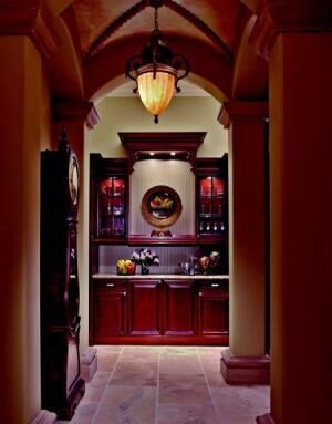 ARCHWAY TO HEAVEN: The groin-vaulted hall flanking the formal dining room culminates at a handsome, yet  practical, butler station, outfitted with supplemental counter and  storage space.