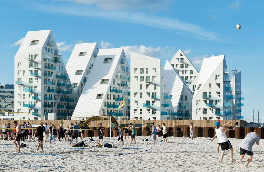 The Julien De Smedt Architects design team hopes to build a warm, vibrant community around the newly constructed Iceberg apartments in Aarhaus, Demark.
