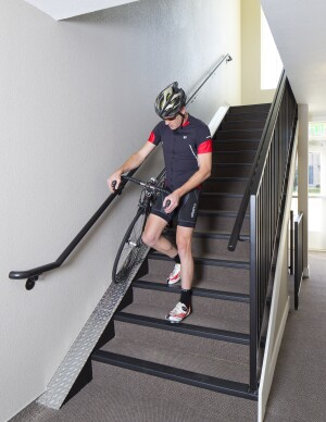 With runnels integrated into the stairways of the walk-up Boulder View Apartments, residents on upper levels can easily push their bicycle to their unit.