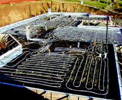 Tubing is tied to the steel reinforcement.