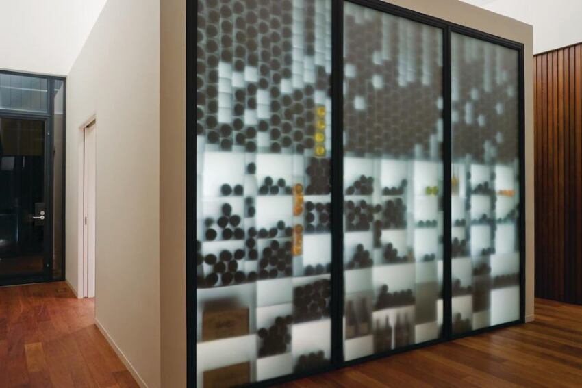 A Long Island residence features its wine cellar upstairs.
