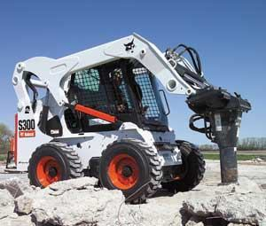 Skidsteers can accommodate a variety of accessory attachments, including one that breaks up concrete.