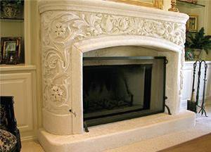 This cast-in-place carved concrete fireplace surround was easier to craft in-place compared to constructing a curved mold for precast work and the results are stunning.