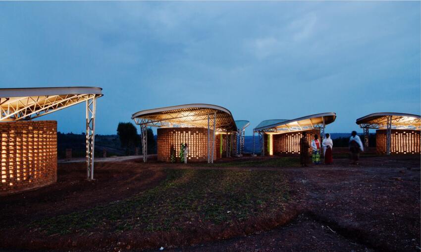 At night, the classrooms glow like filigreed lanterns.
