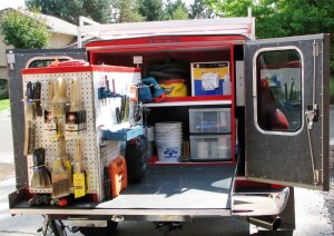 truck bed outfitted with bed slide and custom storage