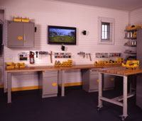In the garage, the air-conditioned workshop bay is filled with both practical items--GarageTek's new Signature line of professional-grade metal cabinets, workbenches, and butcher-block-topped rolling tool chests--and such luxury touches as a plasma TV from Best Buy.