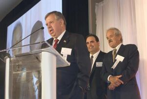 CEO/president Antonio Frias addresses the Massachusetts Building Congress at S&F's induction into the Construction Hall Of Fame. Vice president Joseph Frias and chief operating officer Rodney Frias look on.