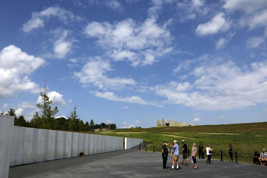 The Flight 93 National Memorial's new visitors center sits on a hill, center rear, overlooking the memorial's Wall of Names, left.