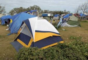 This tent city in the St. Thomas neighborhood, just southwest of the central business district along the river, houses contractors working to rehabilitate a store and other surrounding commercial and private property.